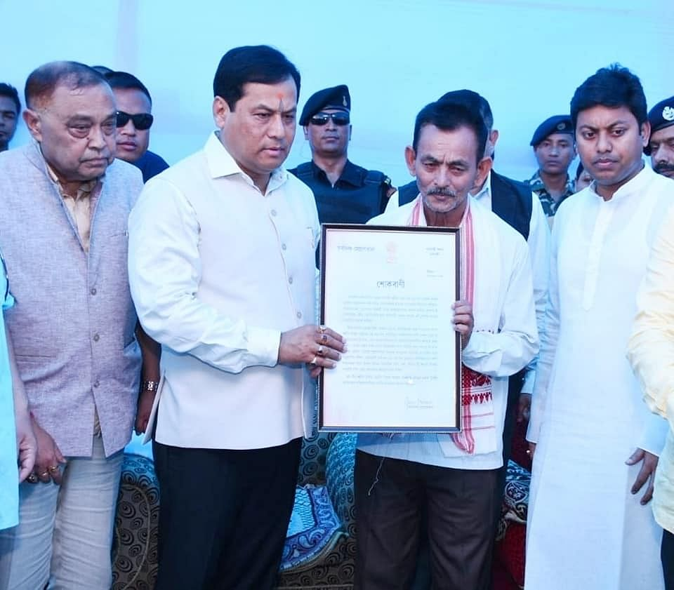 CM Sarbananda Sonowal handing over a condolence message from the state government to the family members of martyr Niraj Chetry