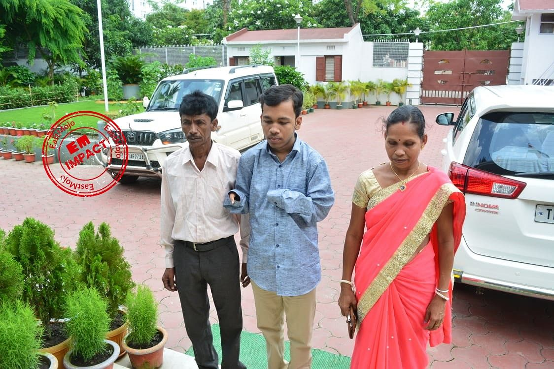 Pralay Dey (centre) with his parents at Tripura CM Biplab Kumar Deb's official residence in Agartala on Monday