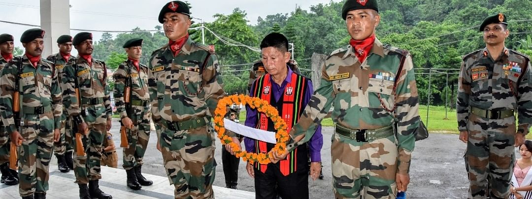 Captain Neikezhakuo Kenguruse's father along with Assam Rifles personnel unveiling the memorial at Sainik School, Punglwa on Monday