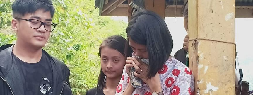 The three children of drowning victim C Lalfakzuala at a function to mark the end of the customary search for his body in Sairang, Mizoram