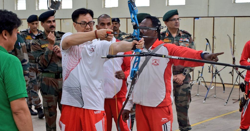 Union minister of state (independent charge) for youth affairs and sports Kiren Rijiju trying his hand at archery