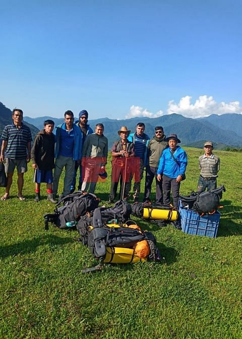 The search and rescue team after being airdropped near the crash site in Arunachal Prdesh on June 12