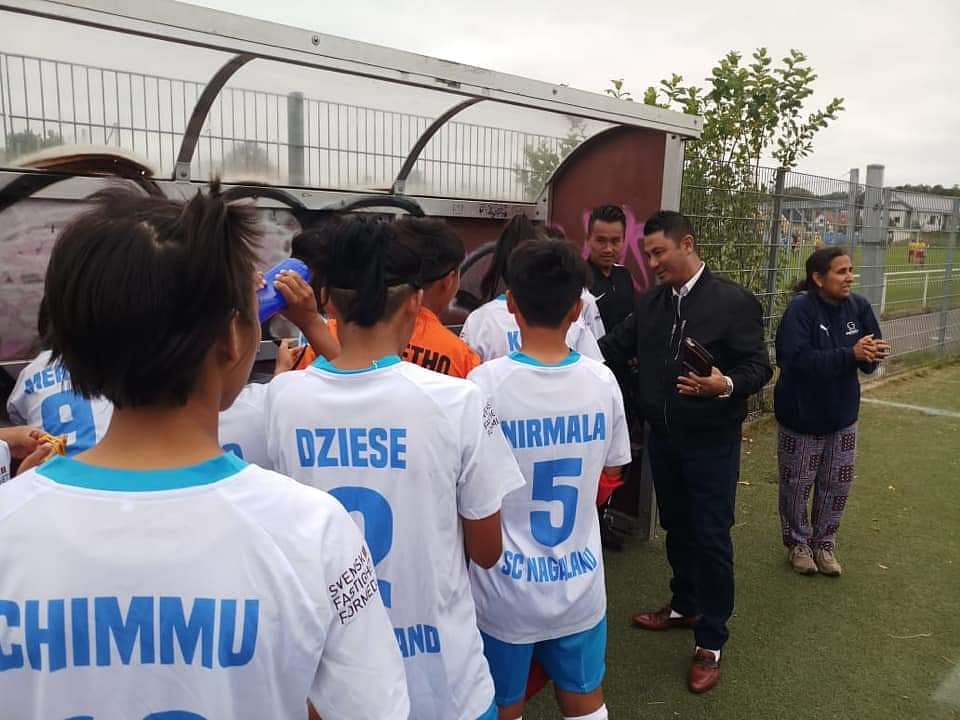 Youth resources and sports adviser Zale Neikha cheering the SC Nagaland U-15 girls' football team members ahead of their match against Vastera BK3