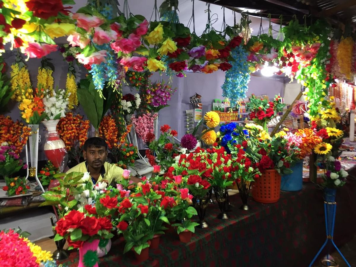 A flower stall set up in the vicinity of Chaturdash Devata Temple in Old Agartala, Tripura