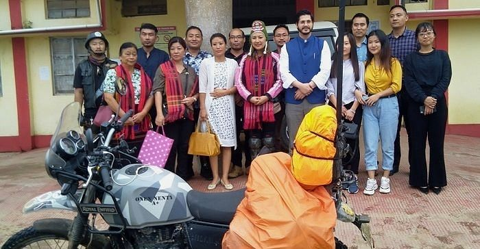 Naga biker Onen Nenty surrounded by friends and well-wishers during her journey