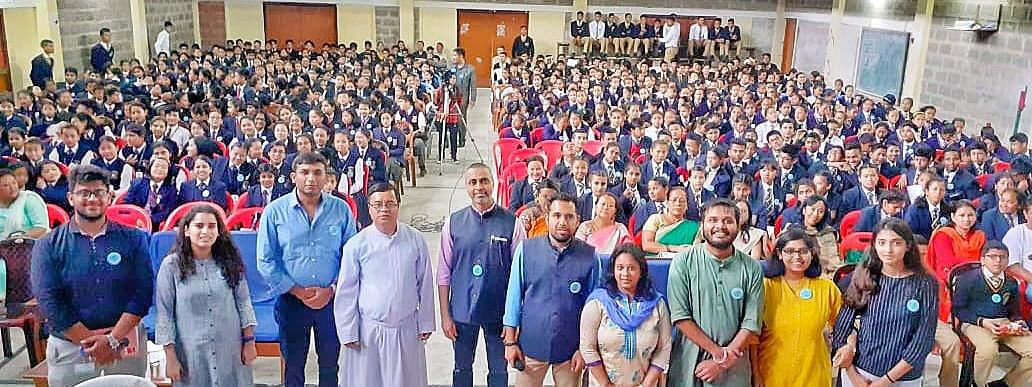 Officials and students during the launch of the educational waste management initiative at St Alphonsus School in Kurseong, Darjeeling