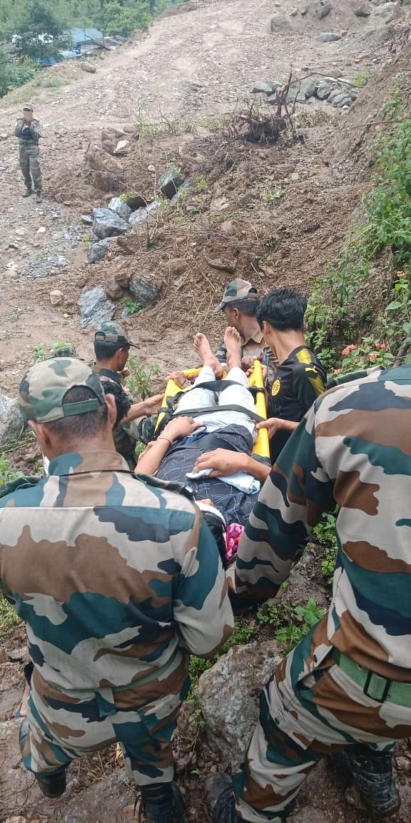 An injured resident being evacuated in Arunachal Pradesh's West Kameng district on Tuesday