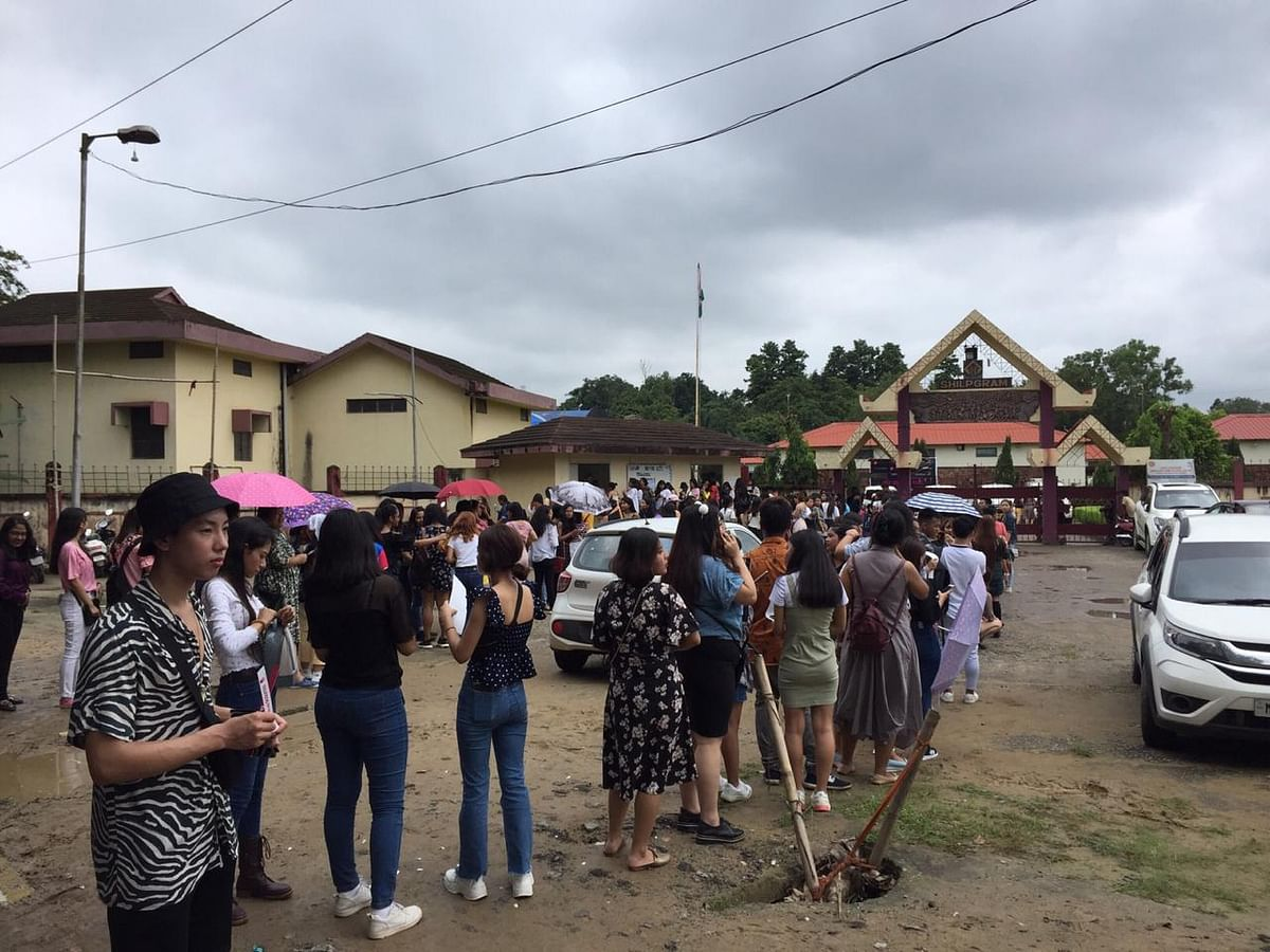 Fans of K-pop band KARD waiting in line to enter the concert arena at Shilpgram in Guwahati, Assam on Sunday afternoon