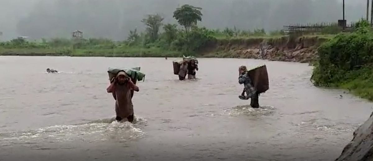 Risking their lives, villagers of Difluso Ronghang village regularly cross the river to carry on with their daily works