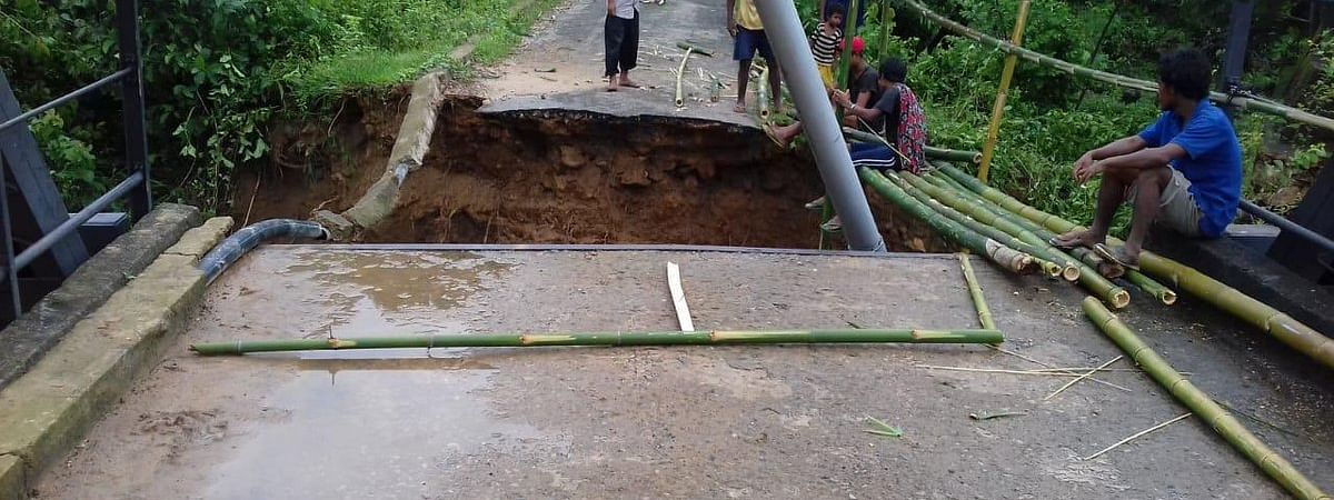 Parts of a bridge that were swept away by a high-flowing stream in Meghalaya