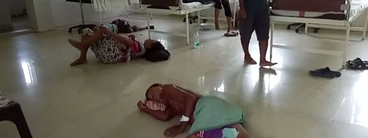Aizak Rai Reang (56) and Sudhanvati Reang (60) sleeping on the floor at the primary healthy centre (PHC) in Gachirampara in North Tripura district