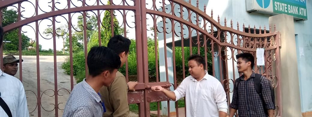 Students' body members opening Assam University Diphu Campus entrance gates after two days of protest on Wednesday
