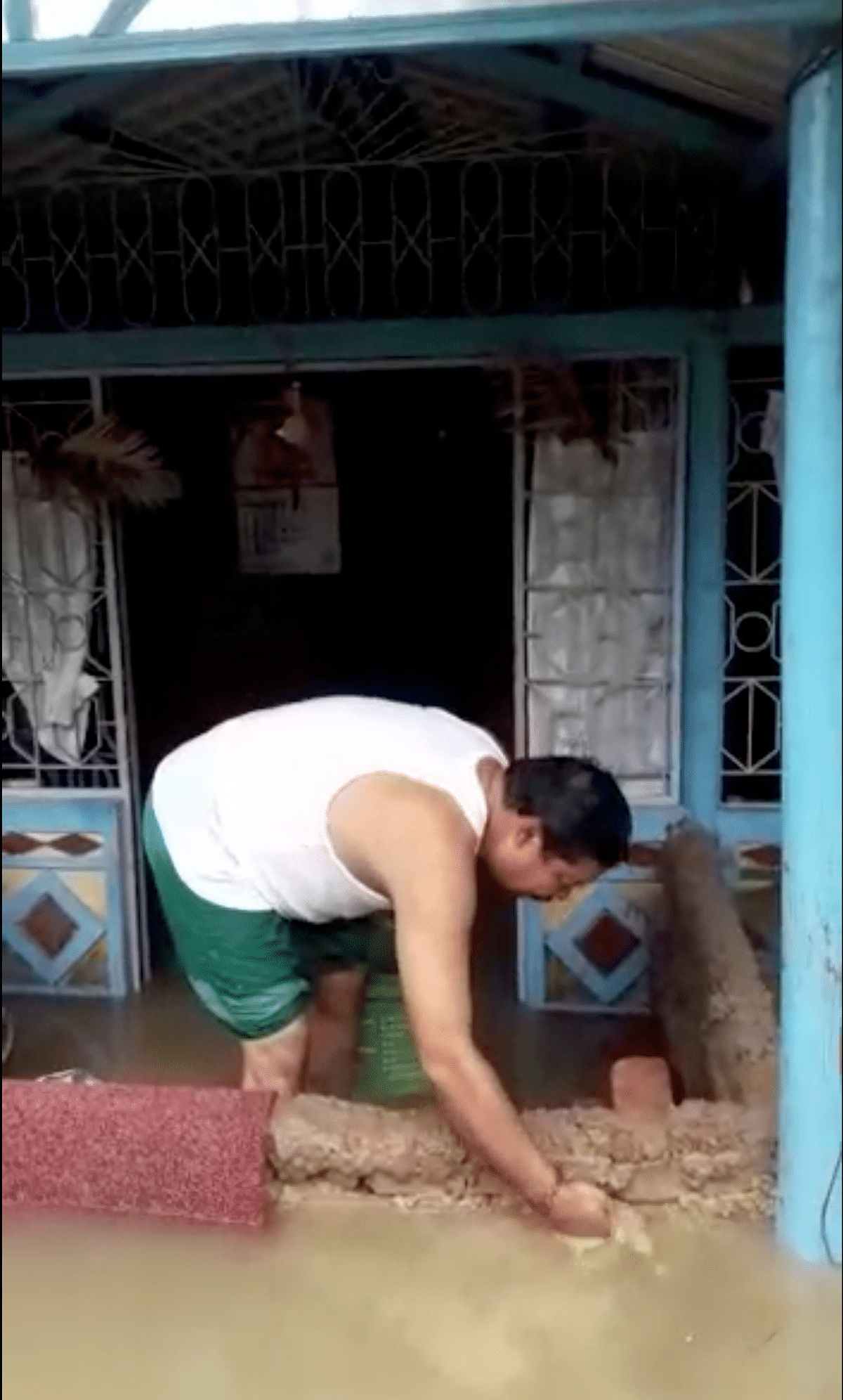 Kokrajhar West MLA Rabiram Narzary trying to drain out water from his house-cum-office in Kokrajhar, Assam