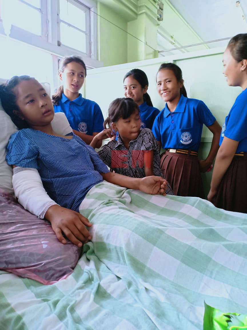 V Lalrinkimi's friends visiting her at Synod Hospital in Durtlang near Aizawl, Mizoram on Wednesday