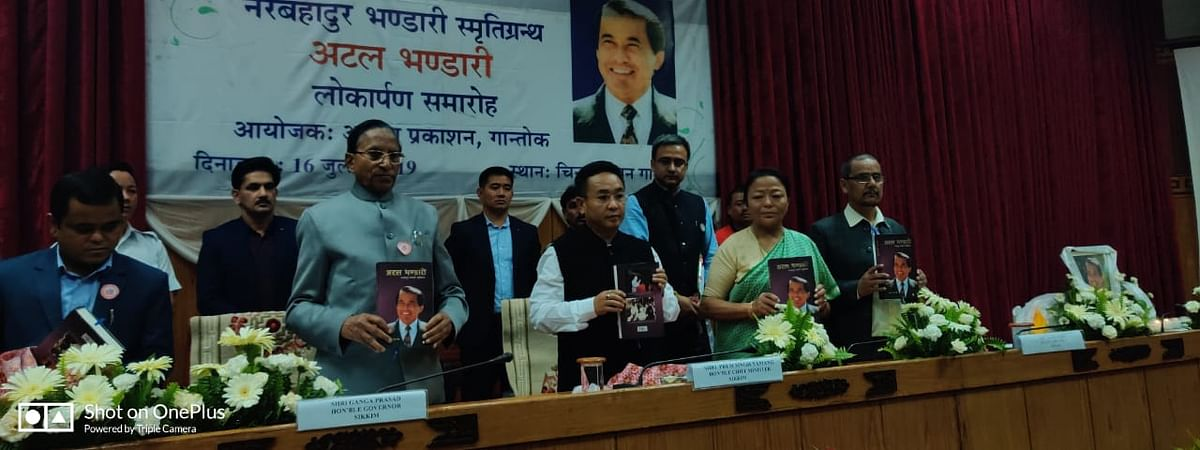 Sikkim governor Ganga Prasad, chief minister PS Golay and Dil Kumari Bhandari, wife of former CM Nar Bahadur Bhandari, during the release of a book titled 'Atal Bhandari', in Gangtok on Tuesday