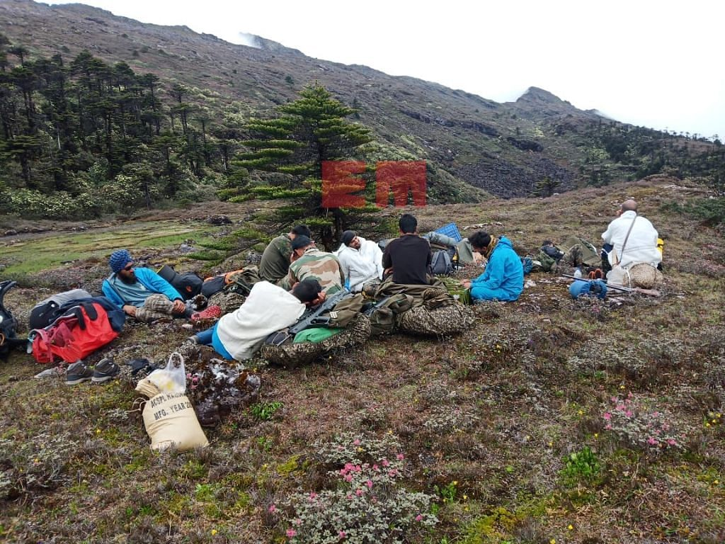 Taka Tamut along with other members of the search and rescue team camping for the night