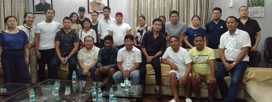 Vangpa Kuponghu (third from left, sitting) with the volunteers who helped in finding him and bringing him safe to Nagaland House in New Delhi