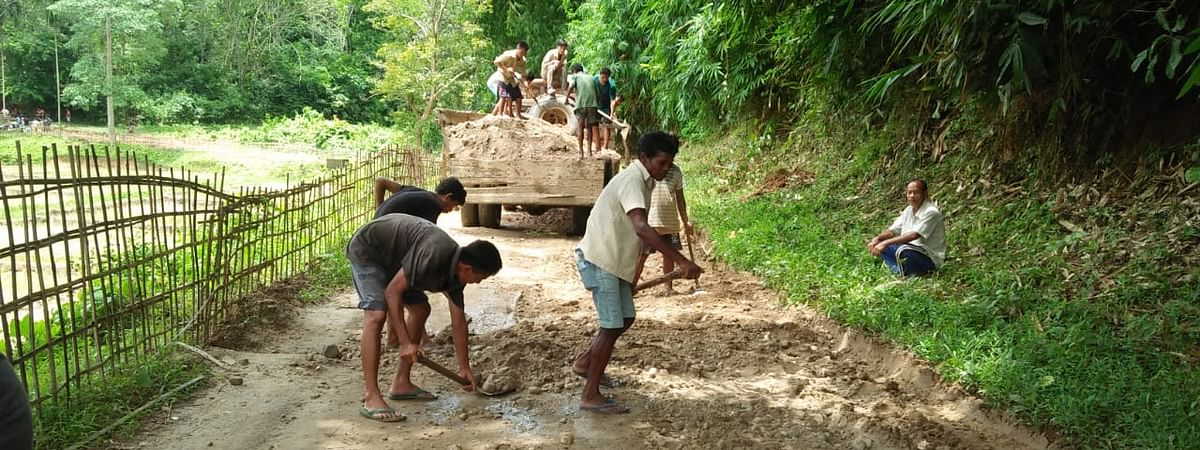 Villagers undertaking repairing works at Malasi village in Karbi Anglong district