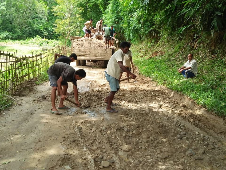 Fed up of neglect, Assam villagers repair road themselves