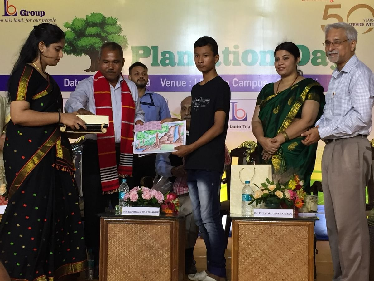 Padma Shri Jadav 'Molai' Payeng, popularly known as the 'forest man of India' (second from left) distributing prizes to the winners of an art competition in Guwahati, Assam on Saturday