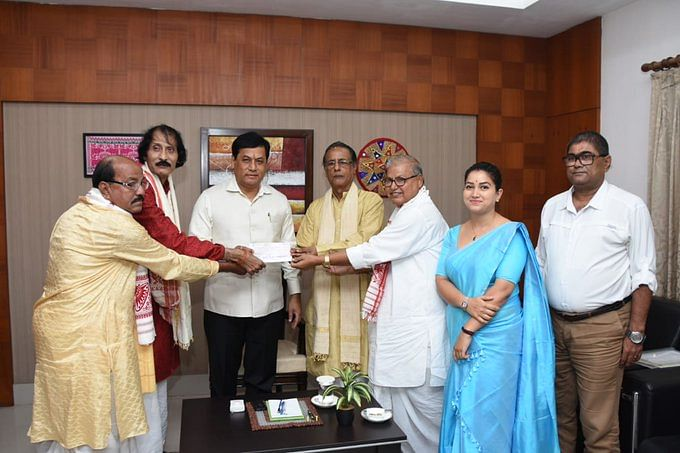 Members of Batadrava Than Parisalona Samiti contributing Rs 1 lakh towards Chief Minister's Relief Fund