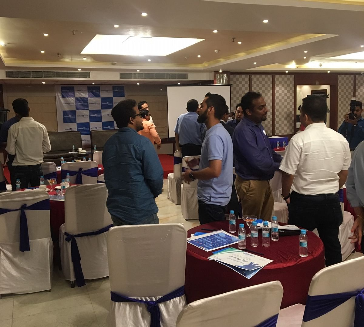 Attendees take part in an open networking session during the LinkedIn Local event in Guwahati, Assam