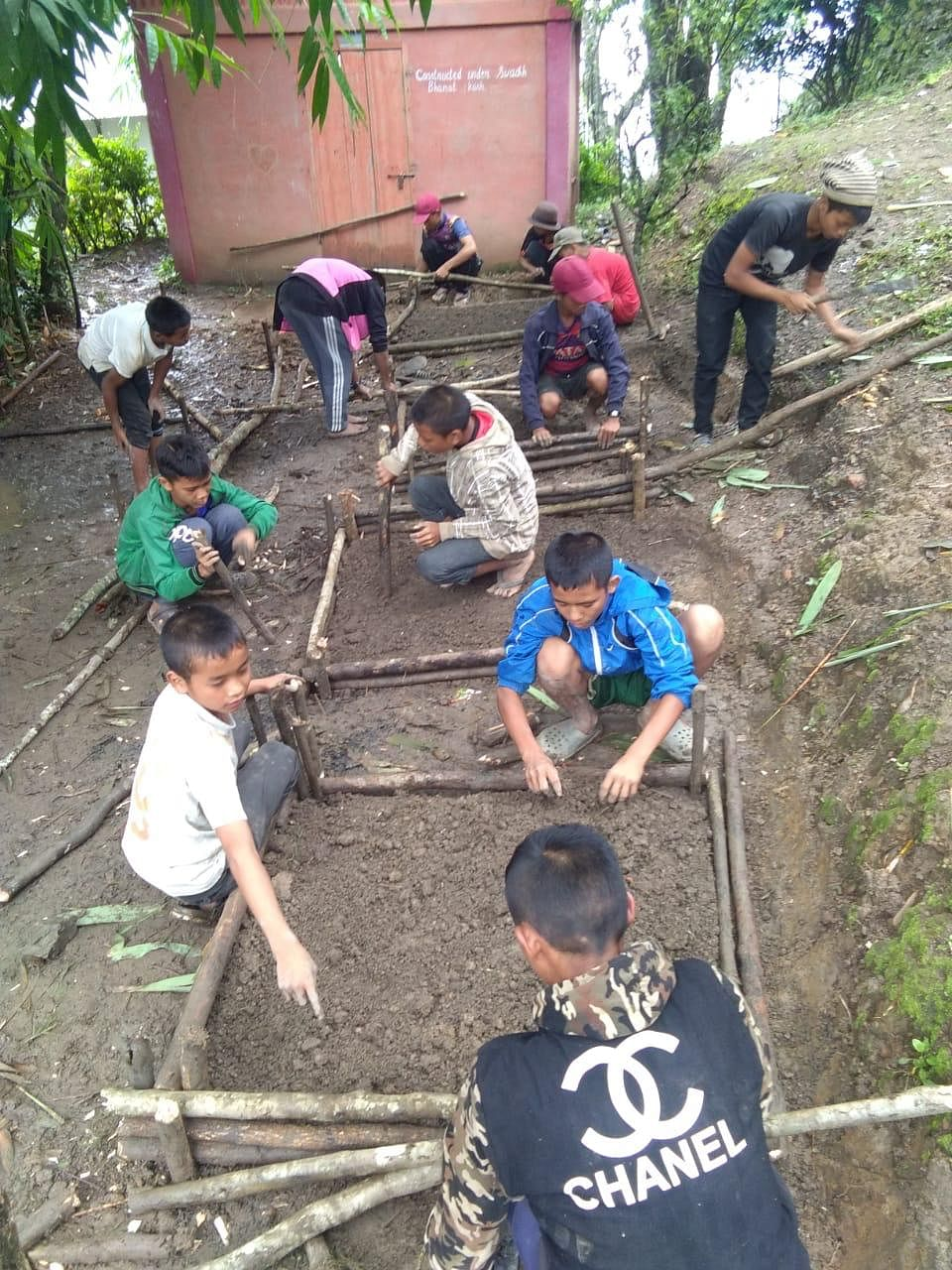 Children preparing a portion of land near their school for growing fruits and vegetables in Mizoram's Lawngtlai district