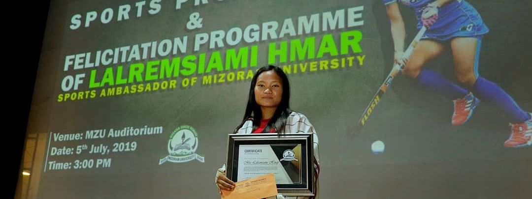 Indian women's hockey player Lalremsiami at a sports promotion and felicitation programme at MZU Auditorium of Mizoram University in Aizawl on Friday