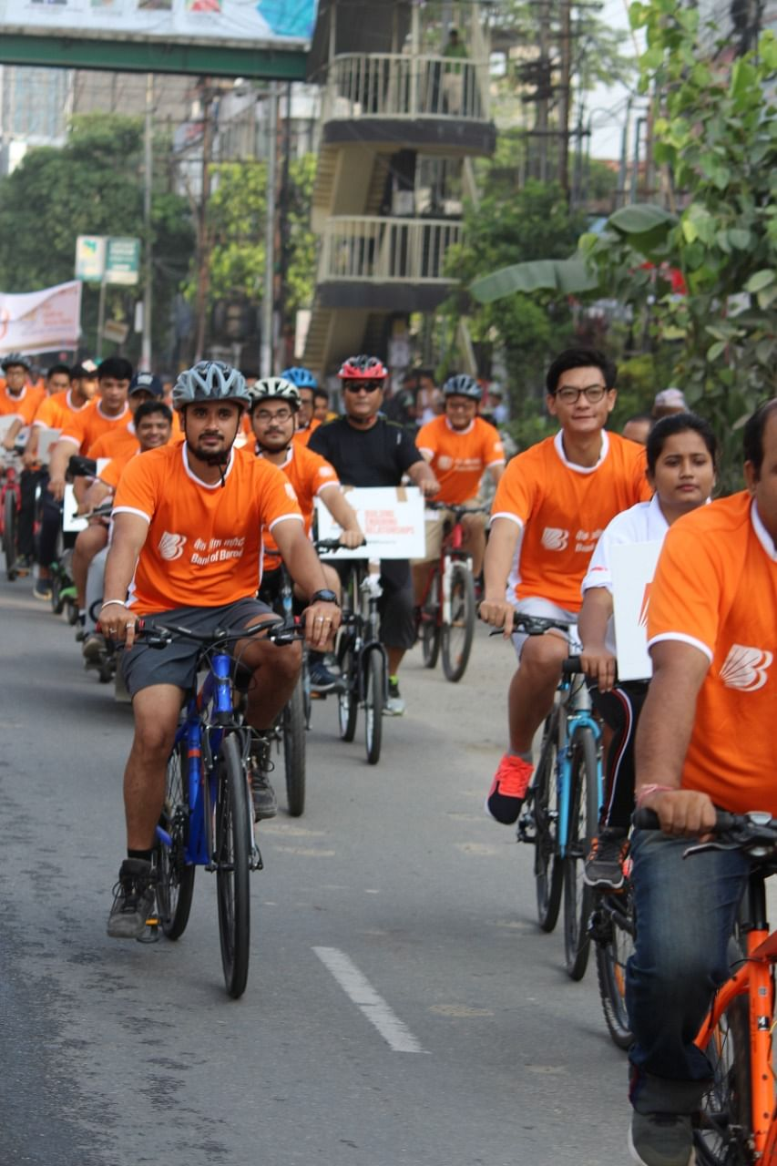 Bank of Baroda staff taking out a bicycle rally in Guwahati to commemorate its 112th foundation day on July 20
