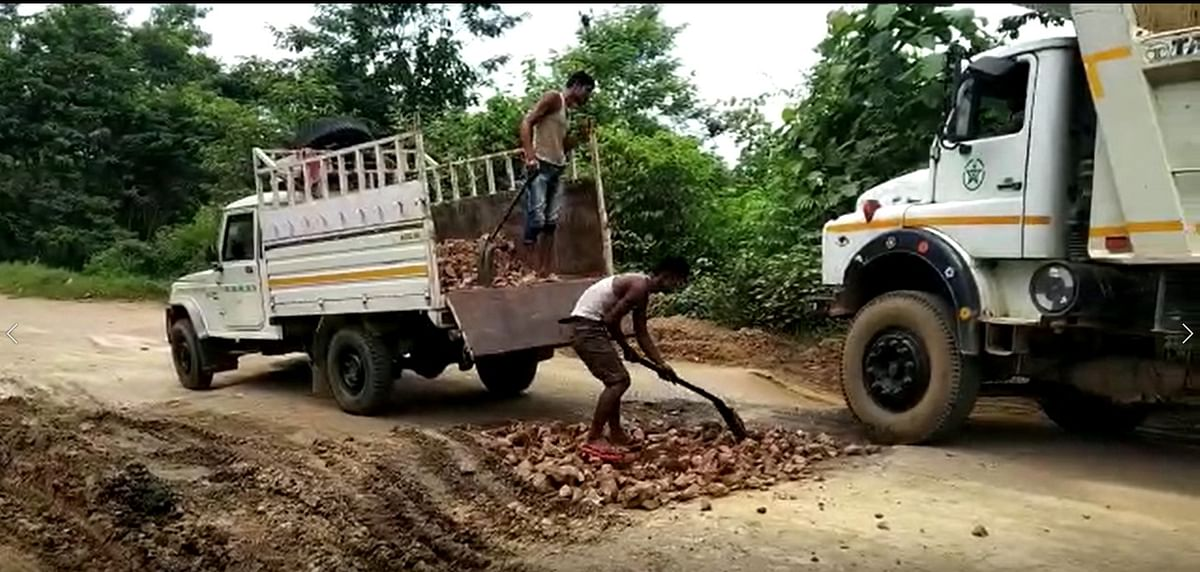 Workers filling up potholes on the Diphu-Manja road on Wednesday ahead of Himanta Biswa Sarma's visit to the district on Thursday