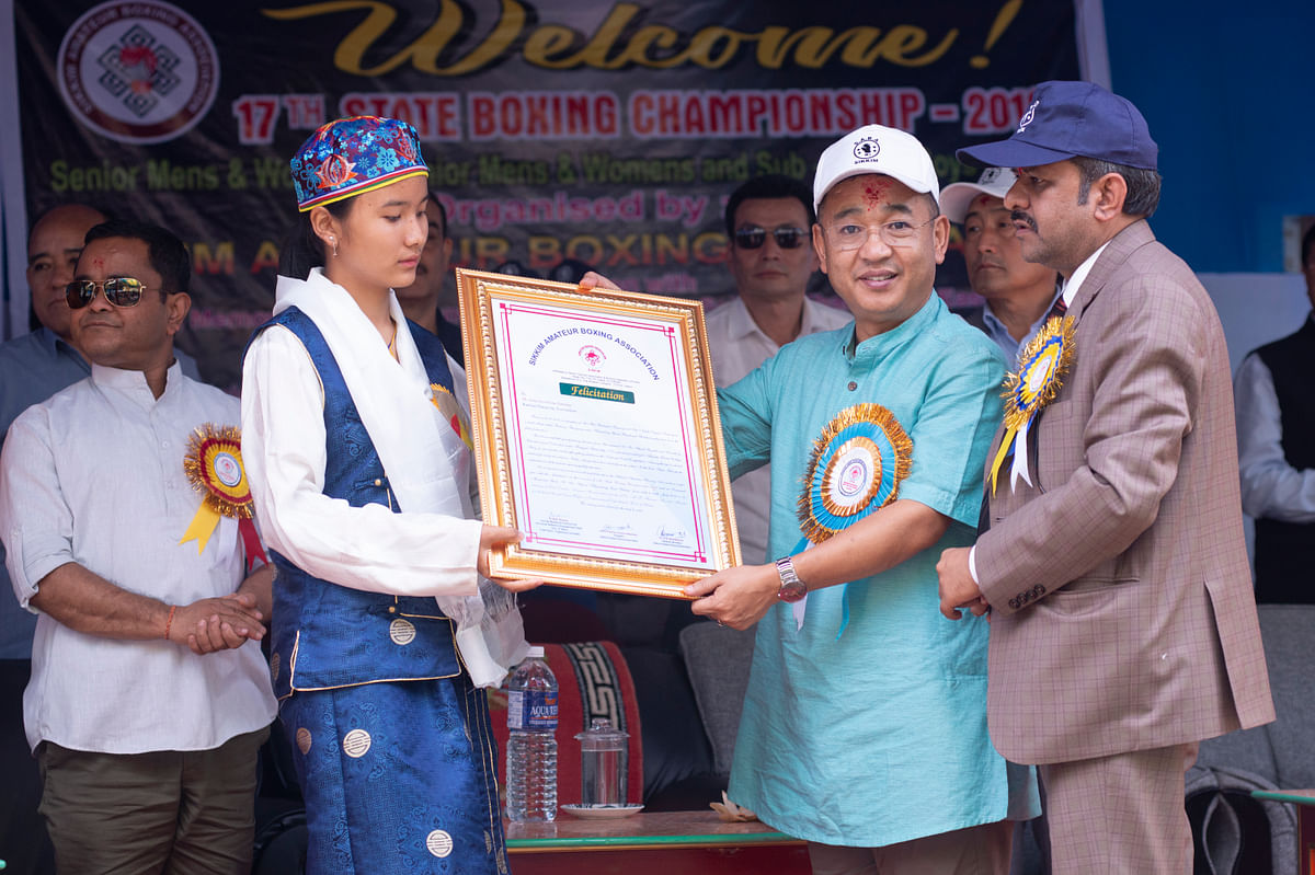 Yangchen Doma Tamang being felicitated by Sikkim chief minister PS Golay at the XVIIth State Level Boxing Championship in Khamdong on Friday