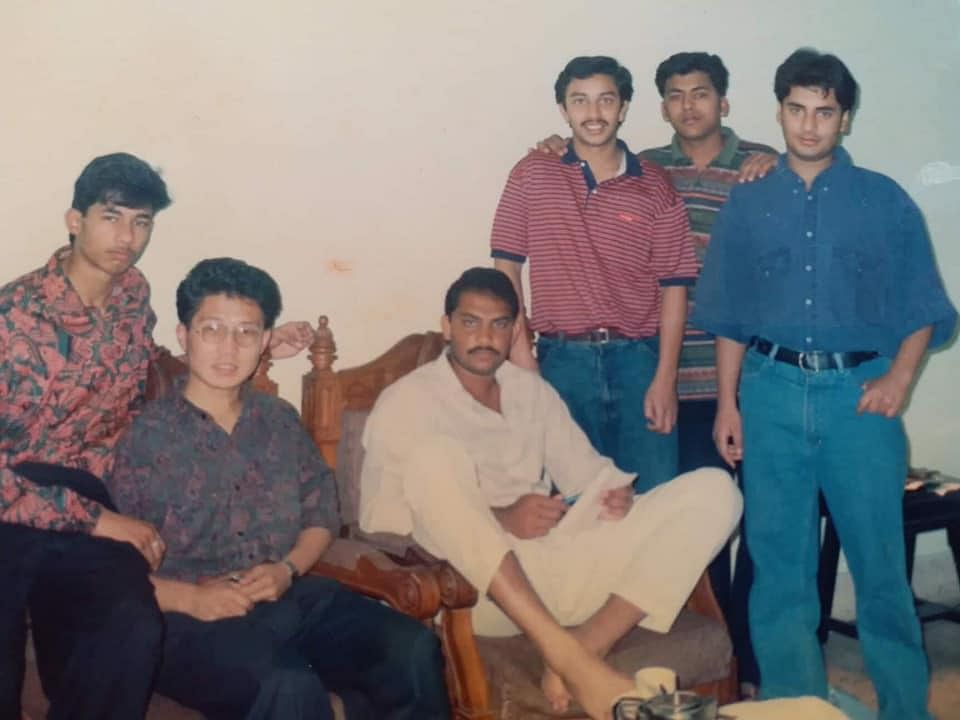 Former Indian captain Mohammad Azharuddin (in white, sitting) with former Guwahati hotelier Agnirath Chowdhury (extreme right) and others in Guwahati during the early 1990s