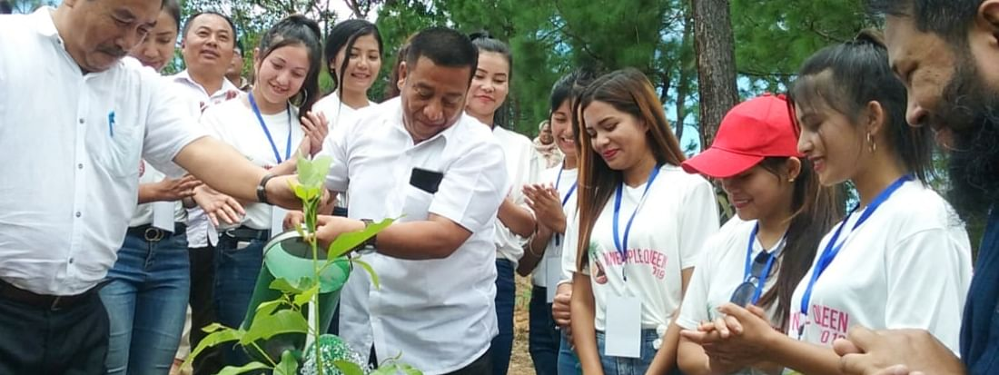 Manipur forest and environment minister Thounaojam Shyamkumar watering a sapling as part of Van Mohatsava 2019 at Imphal East on Wednesday
