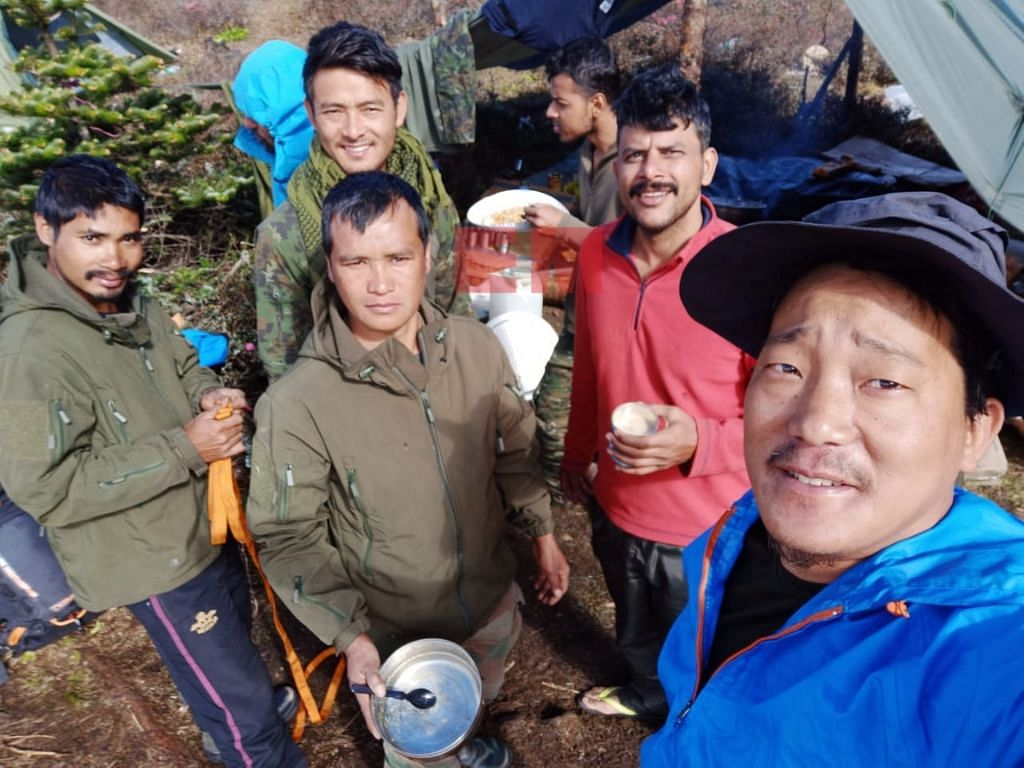 Taka Tamut with other members of the search and rescue team in Arunachal Pradesh