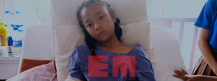 V Lalrinkimi at Synod Hospital, Durtlang in Mizoram on Wednesday. The 12-year-old girl's left hand got burnt, left leg stitched and has a swollen waist