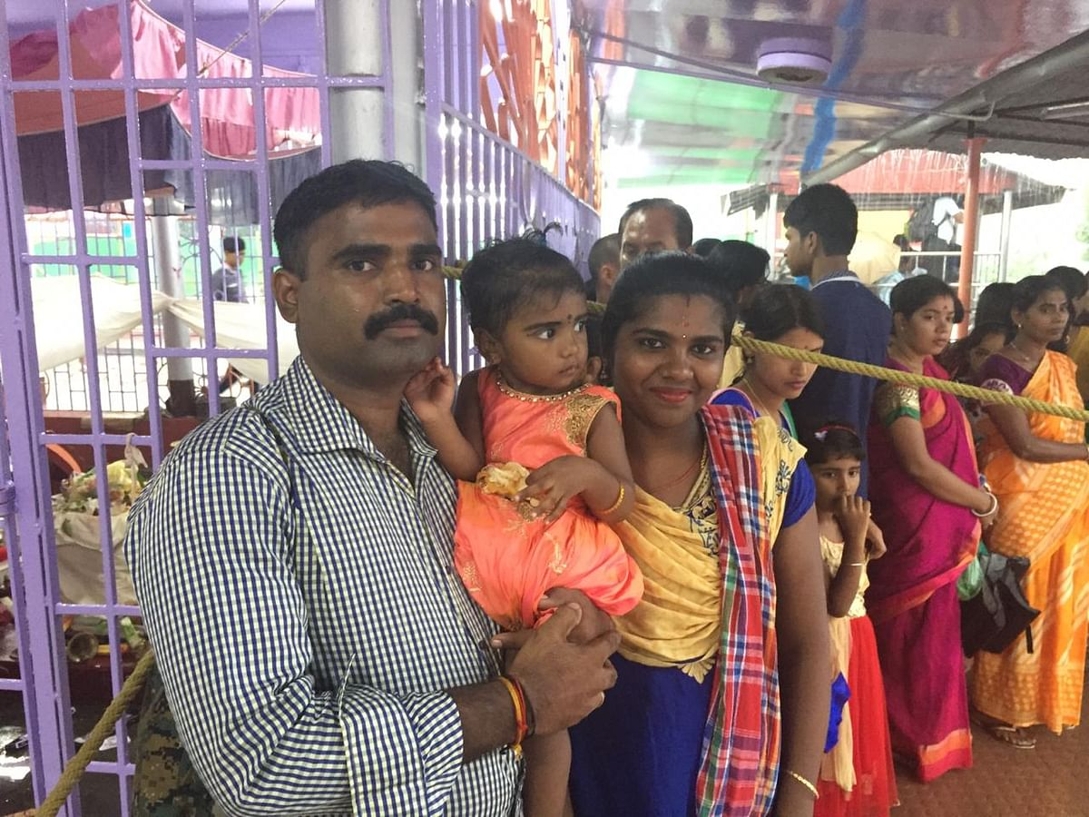 Ayayapan, a devotee from Tamil Nadu, with his family during Kharchi Mela