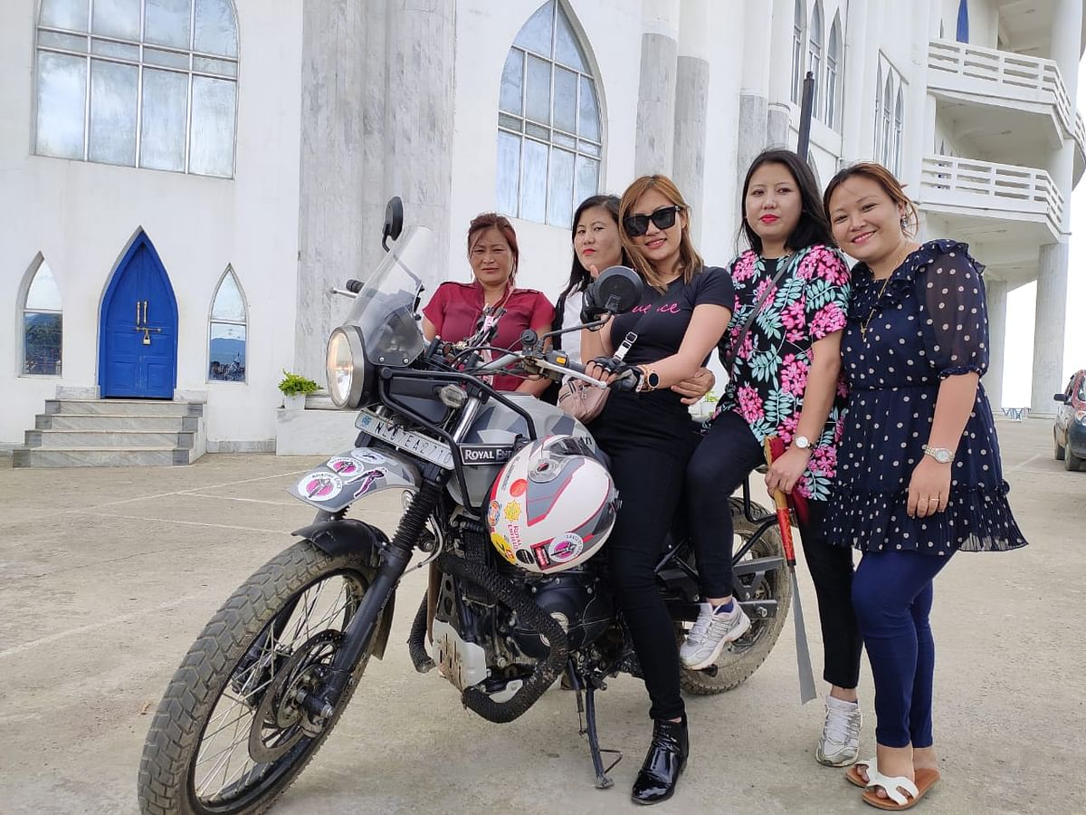Nagaland biker Onen Nenty outside Asia's largest church in Zunheboto district of Nagaland