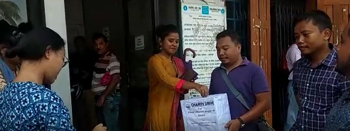 District Press Club of Karbi Anglong members conducting a charity drive in Diphu town in aid of flood victims in Assam on Friday