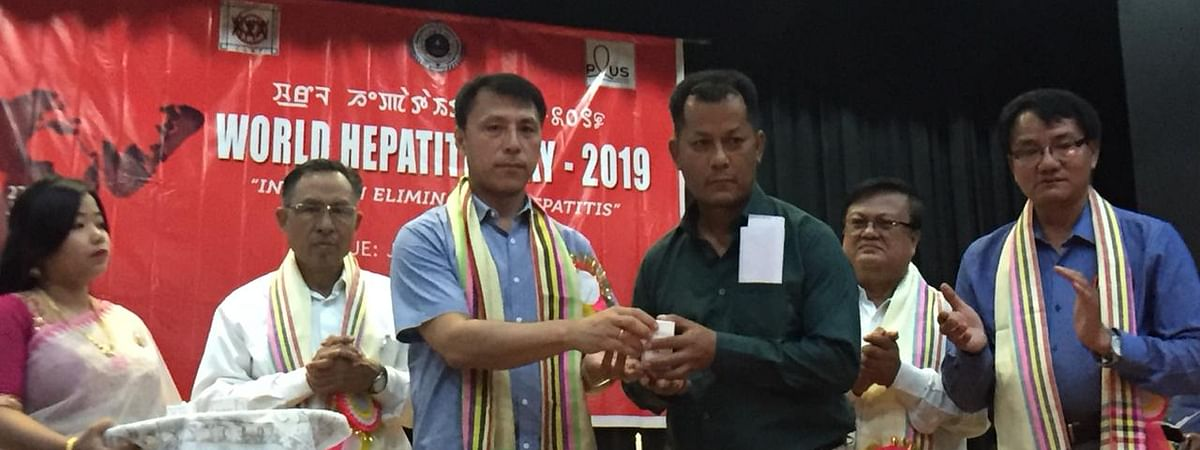 Manipur education minister Th Radheshyam SIngh distributing free medicines to patients to mark World Hepatitis Day in Imphal