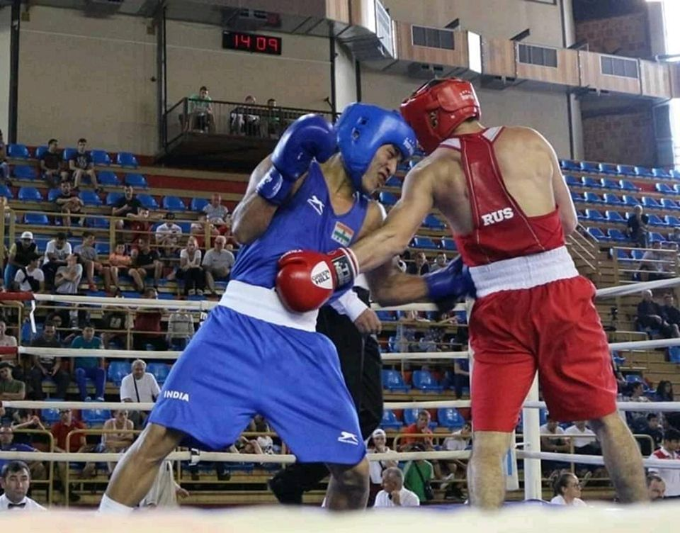 Boxer Bilotson L Singh taking on his opponent Boris Karibian of Russia during the final match