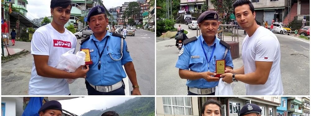 Youngsters in Gangtok handing over lunch packs and mementos to traffic personnel