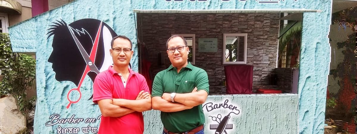 Twin brothers Paonam Sunder Singh (left) and Paonam Prem Singh, the co-founders of 'Barber on Wheel' in Imphal, Manipur
