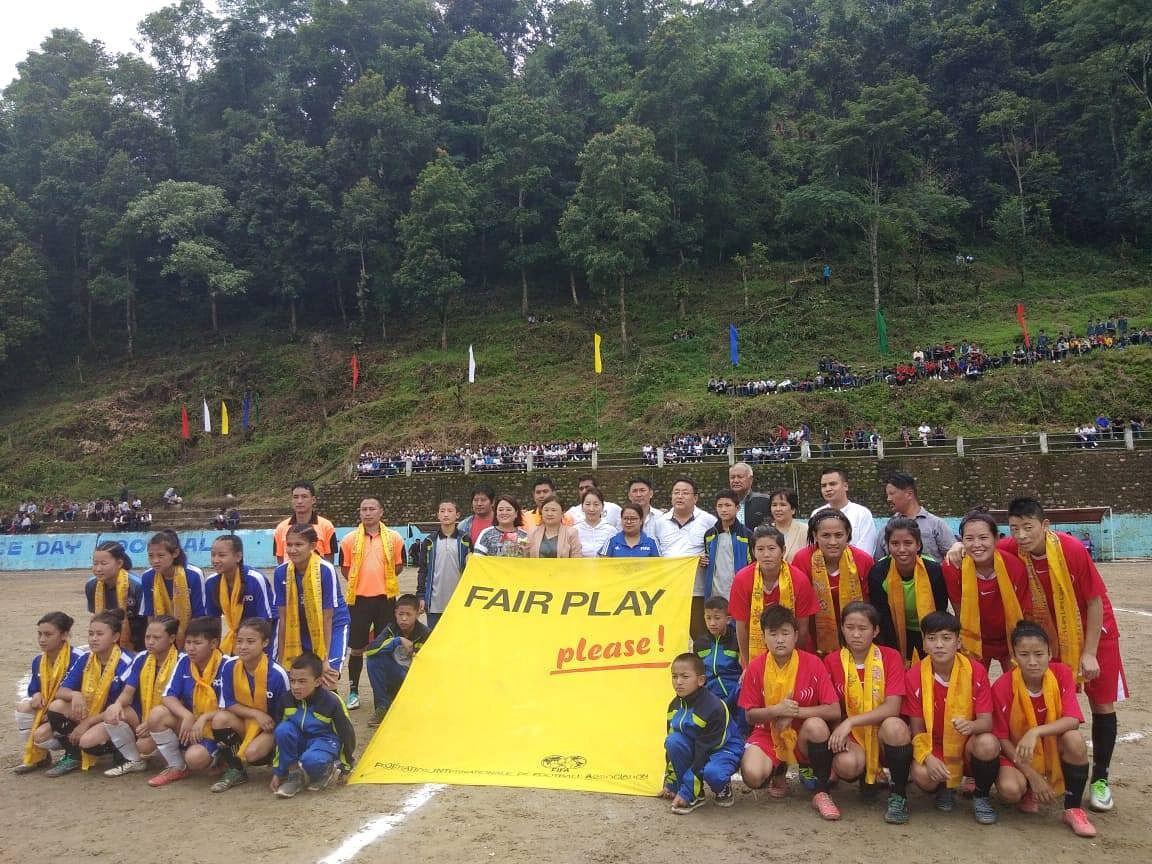 Women football players before the start of a match in South Sikkim