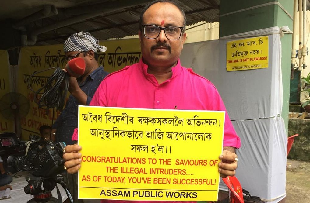 Assam Public Works president Abhijit Sarma holding a placard expressing his displeasure over the final list of the NRC in Assam