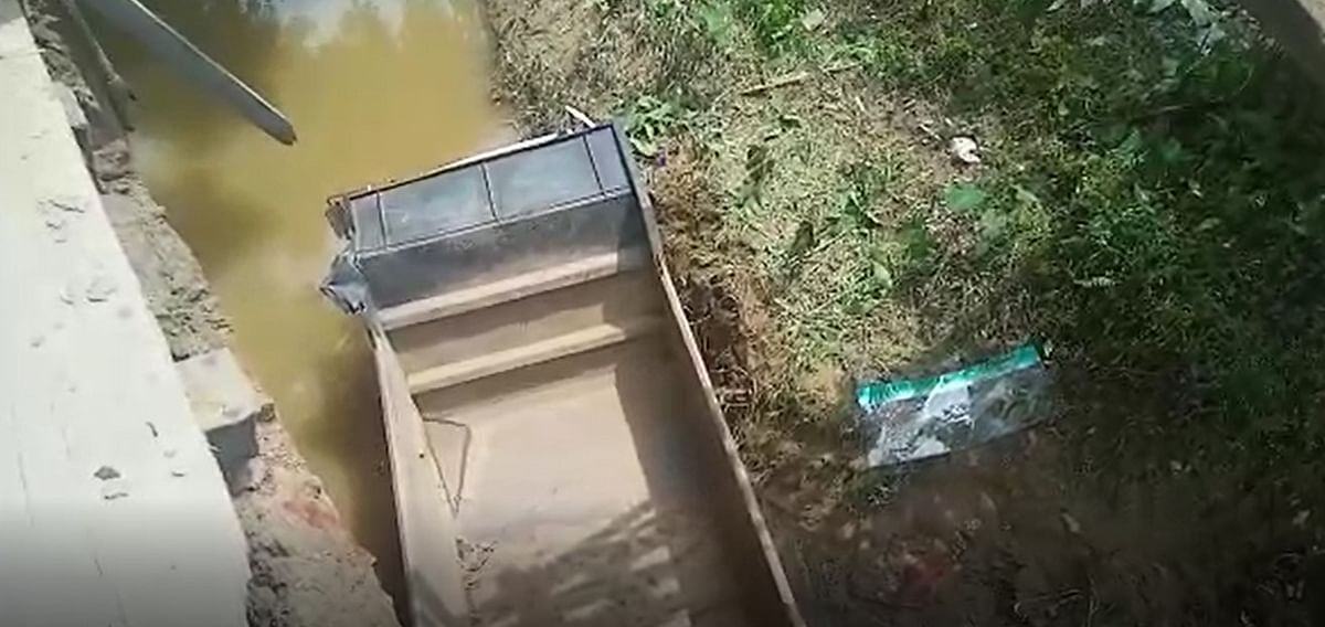 Dumper en route to Nagaland fell off and landed on the river as the shabby wooden bridge collapsed