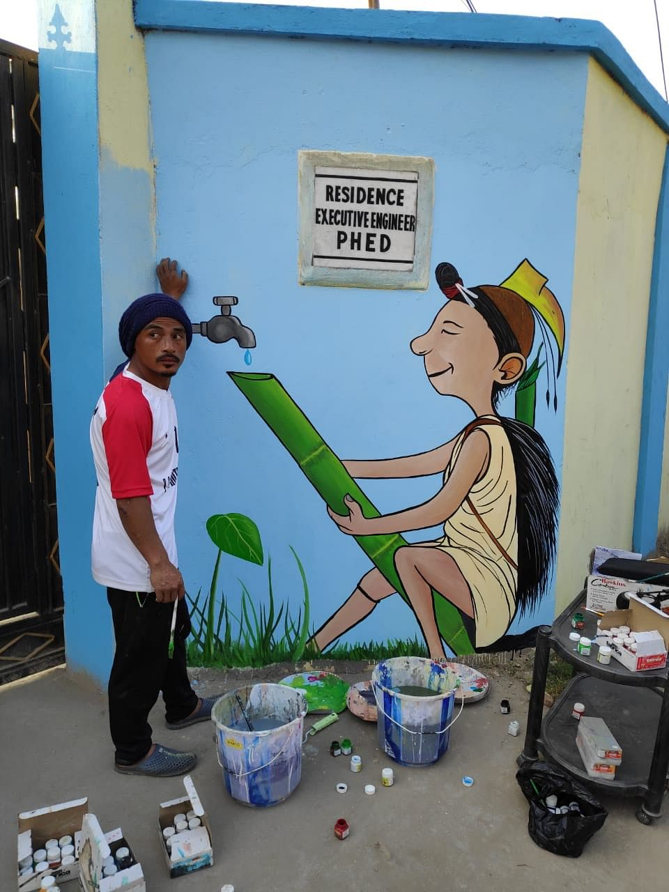 One of the youths after painting the wall of the PHED executive engineer's residence in Seppa of Arunachal Pradesh's East Kameng district
