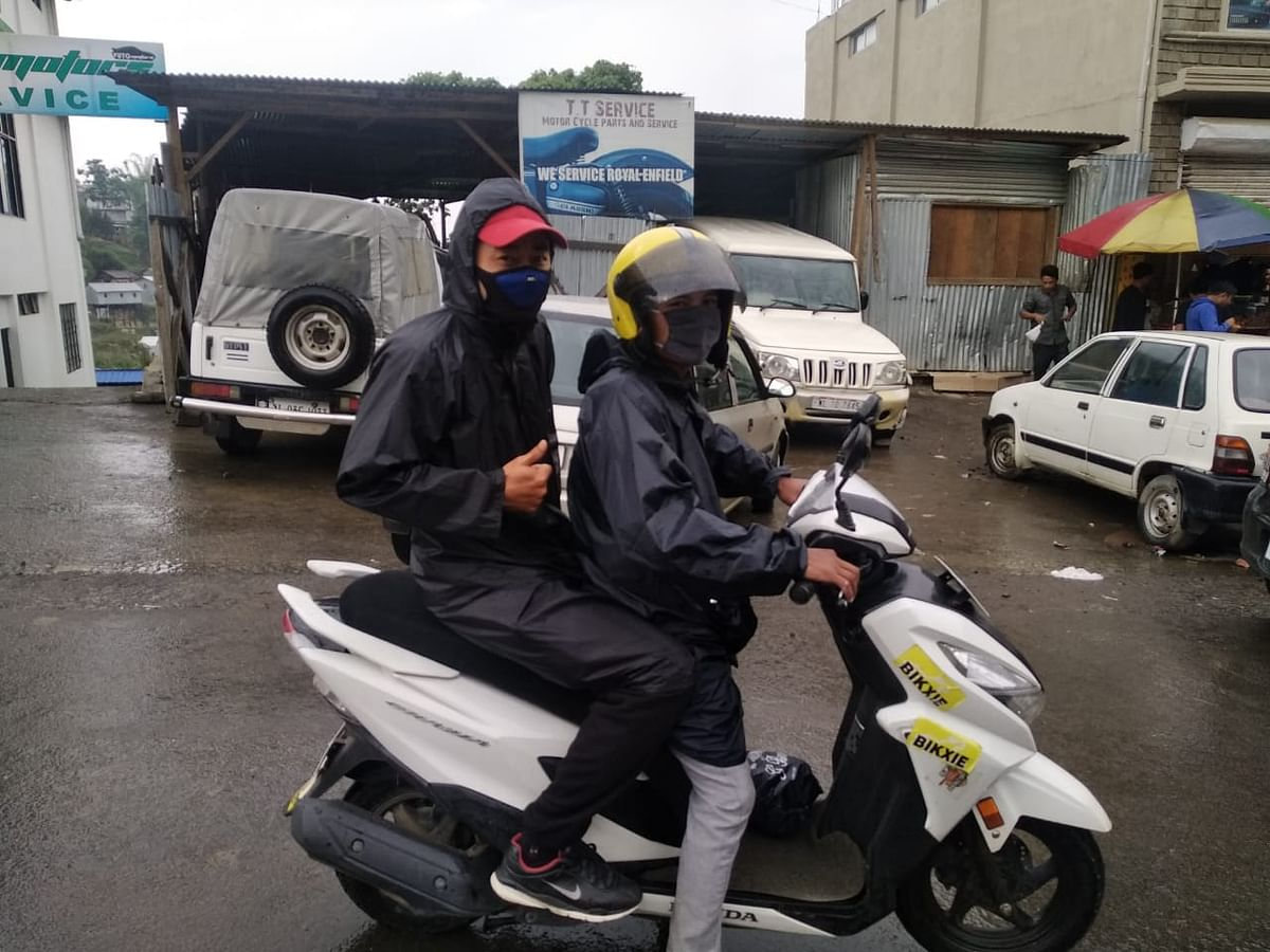 A two-wheeler taxi rider giving a free ride to one of the LDA examination aspirants in Kohima, Nagaland on Saturday