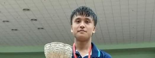 Maisnam Meiraba Luwang with the trophy at the 28th Yonex-Sunrise Smt Krishna Khaitan Memorial All India Junior Ranking Badminton Tournament in Haryana