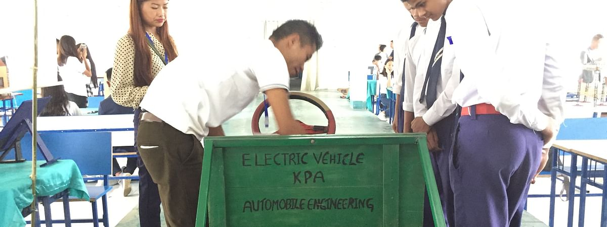 School students pay attention as a participant demonstrates an 'electric vehicle' project at Tech Fest in Kohima, Nagaland on Friday