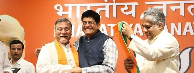 Union minister Piyush Goyal (centre) with former Rajya Sabha MP Bhubaneswar Kalita (left) at the BJP headquarters in New Delhi on Friday